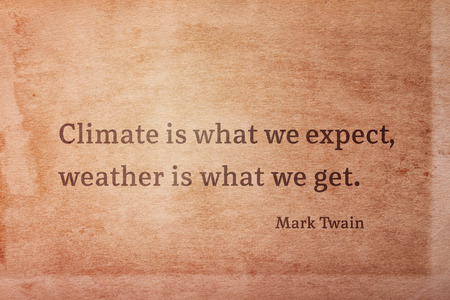 Climate is what we expect, weather is what we get - famous American writer Mark Twain quote printed on vintage grunge paper 版權商用圖片