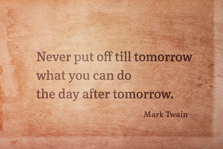 Never put off till tomorrow what you can do the day after tomorrow - famous American writer Mark Twain quote printed on vintage grunge paper 版權商用圖片