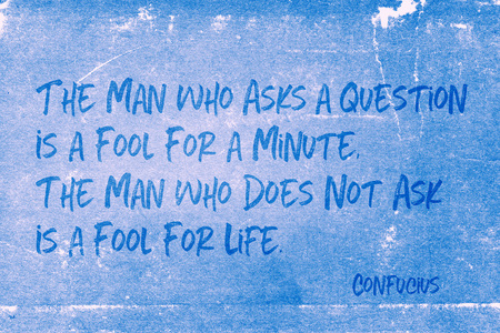 The man who asks a question is a fool for a minute - ancient Chinese philosopher Confucius quote printed on grunge blue paper
