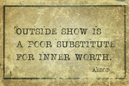 Outside show is a poor substitute for inner worth - famous ancient Greek story teller Aesop quote printed on grunge vintage cardboard Stock Photo