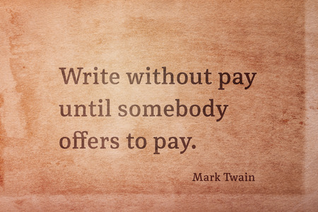 Write without pay until somebody offers to pay - famous American writer Mark Twain quote printed on vintage grunge paper 版權商用圖片