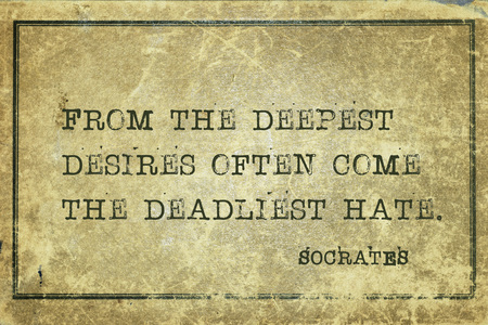 From the deepest desires often come the deadliest hate - ancient Greek philosopher Socrates quote printed on grunge vintage cardboard
