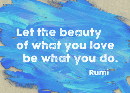 Let the beauty of what you love be what you do - ancient Persian poet and philosopher Rumi quote printed on blue palette paint Stock Photo