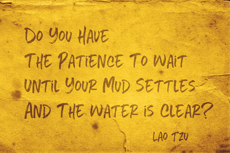 Do you have the patience to wait until your mud settles and the water is clear? - ancient Chinese philosopher Lao Tzu quote printed on grunge yellow paper Archivio Fotografico - 118671770