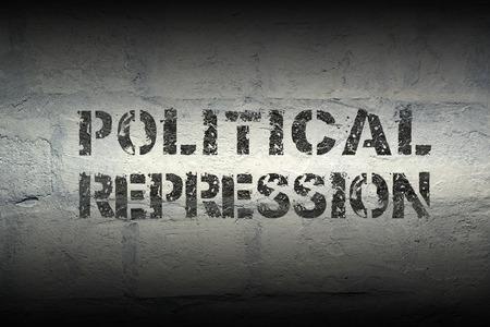 political repression stencil print on the grunge white brick wall
