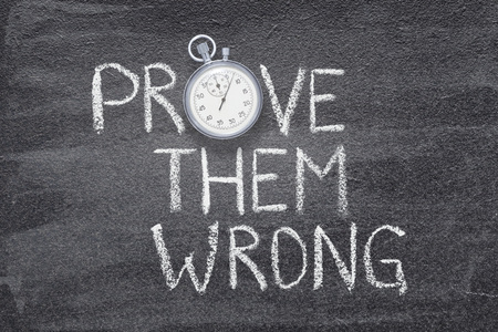 prove them wrong written on chalkboard with vintage stopwatch used instead of O Stock fotó