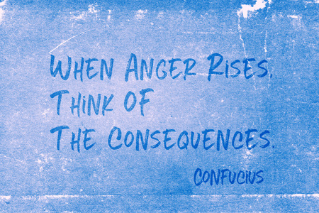When anger rises, think of the consequences - ancient Chinese philosopher Confucius quote printed on grunge blue paper Foto de archivo - 120915587