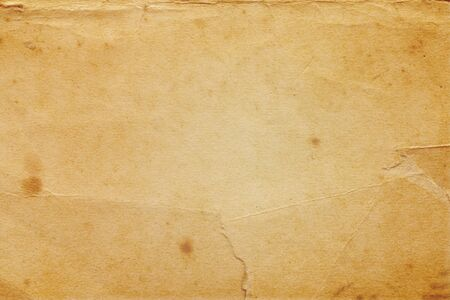 detailed yellowish vintage paper texture with many dents and scratches Stok Fotoğraf