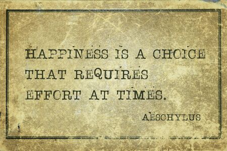 Happiness is a choice that requires effort at times - famous ancient Greek tragedian Aeschylus quote printed on grunge vintage cardboard 写真素材