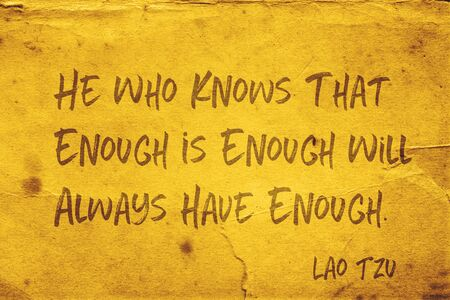 He who knows that enough is enough will always have enough - ancient Chinese philosopher Lao Tzu quote printed on grunge yellow paper