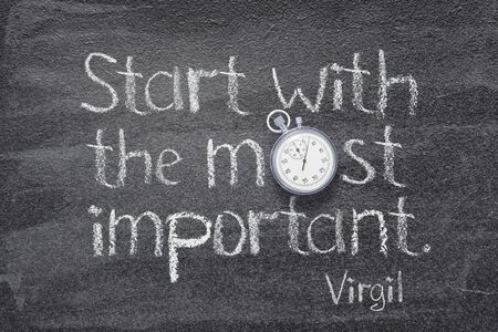 Start with the most important - quote of ancient Roman poet Virgil written on chalkboard with vintage precise stopwatch