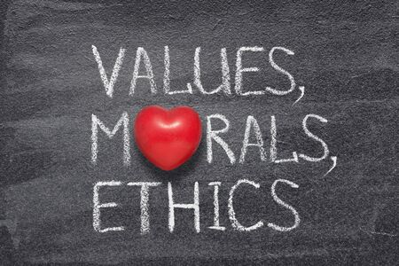 values, morals, ethics words written on chalkboard with red heart symbol instead of O Фото со стока