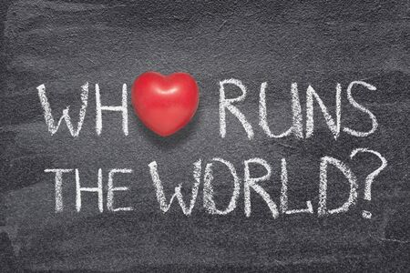 who runs the world phrase handwritten on chalkboard with red heart symbol instead of O
