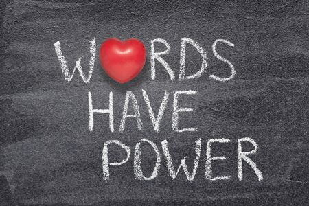 words have power phrase written on chalkboard with red heart symbol instead of O