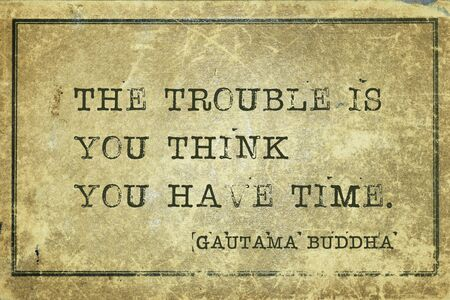 The trouble is you think you have time - famous quote of Gautama Buddha printed on grunge vintage cardboard Фото со стока