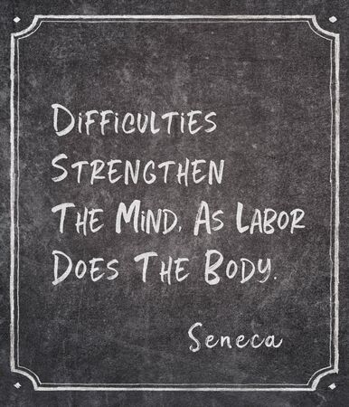 Difficulties strengthen the mind, as labor does the body - ancient Roman philosopher Seneca quote written on framed chalkboard Banco de Imagens