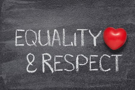 equality and respect phrase written on chalkboard with red heart symbol Standard-Bild