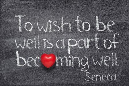 To wish to be well is a part of becoming well - quote of ancient Roman philosopher Seneca written on chalkboard with red heart instead of O
