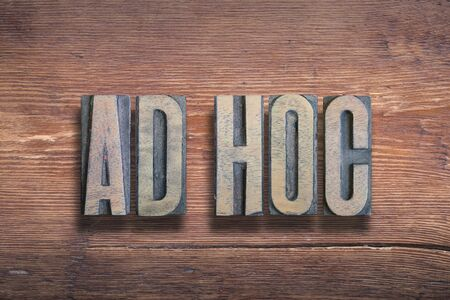 ad hoc ancient Latin saying meaning - to this, combined on vintage varnished wooden surface