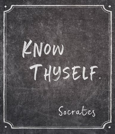 Know thyself - ancient Greek philosopher Socrates quote written on framed chalkboard