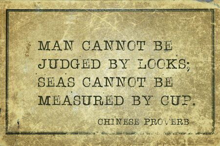Man cannot be judged by looks; seas cannot be measured by cup - ancient Chinese proverb printed on grunge vintage cardboard