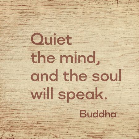 Quiet the mind, and the soul will speak - famous quote of Gautama Buddha printed on grunge wooden board