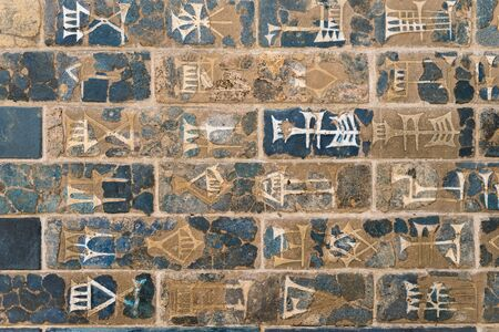 ancient wall background decorated by Babylonian hieroglyphs Stock Photo