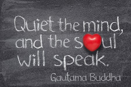 Quiet the mind, and the soul will speak - quote of Gautama Buddha written on chalkboard with red heart symbol instead of O Imagens