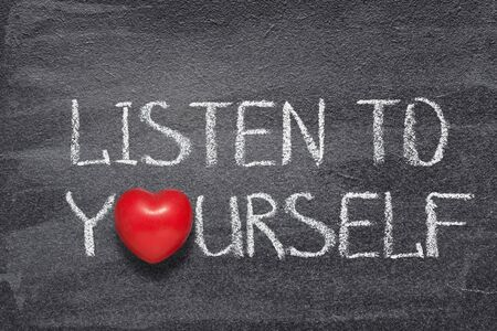 listen to yourself phrase written on chalkboard with red heart symbol