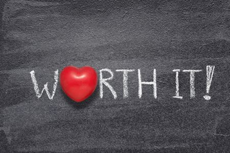 worth it exclamation written on chalkboard with red heart symbol