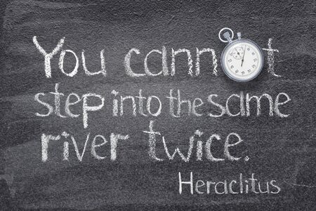 You cannot step into the same river twice - quote of ancient Greek philosopher Heraclitus written on chalkboard with vintage stopwatch instead of O