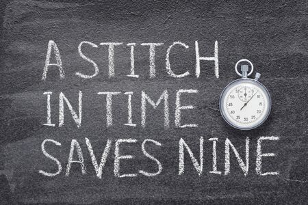 A stitch in time saves nine saying written on chalkboard with vintage precise stopwatch
