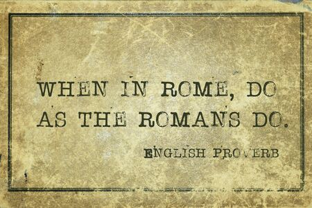 When in Rome, do as the Romans do - ancient English proverb printed on grunge vintage cardboard