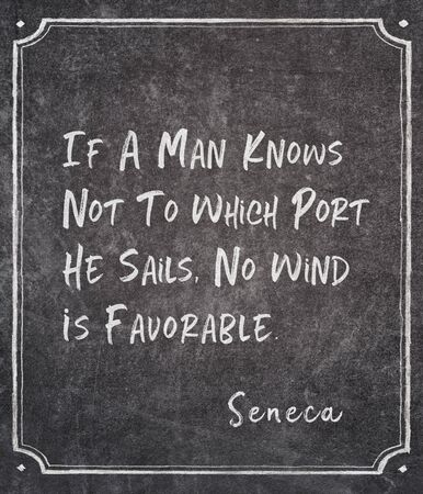 If a man knows not to which port he sails, no wind is favorable - ancient Roman philosopher Seneca quote written on framed chalkboard Banco de Imagens