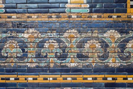 detailed flower ornament on glazed ceramic wall from ancient Babylon