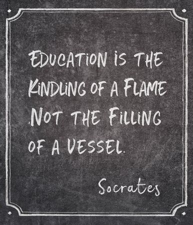 Education is the kindling of a flame, not the filling of a vessel - ancient Greek philosopher Socrates quote written on framed chalkboard