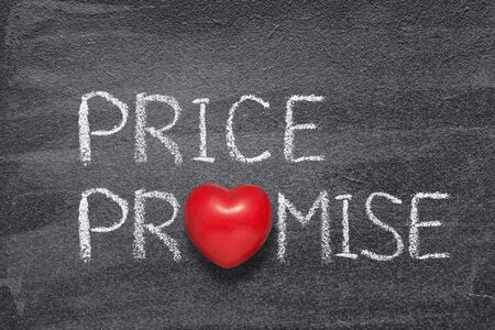 price promise phrase written on chalkboard with red heart symbol