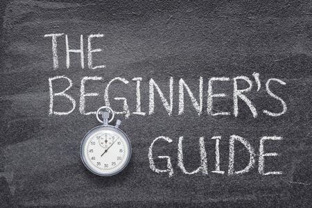 the beginner's guide phrase written on chalkboard with vintage precise stopwatch 版權商用圖片