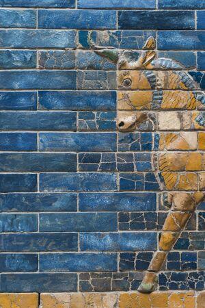 fragment of Aurochs symbol of Hadad deity on blue ceramic wall from ancient Babylon Imagens
