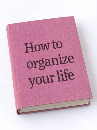 how to organize life phrase printed on textile book cover