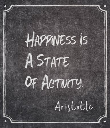 Happiness is a state of activity - ancient Greek philosopher Aristotle quote written on framed chalkboard Archivio Fotografico - 147906591