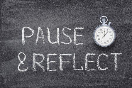 pause and reflect phrase written on chalkboard with vintage precise stopwatch Reklamní fotografie