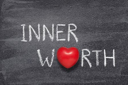 inner worth phrase written on chalkboard with red heart symbol
