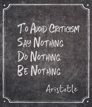 To avoid criticism say nothing, do nothing, be nothing - ancient Greek philosopher Aristotle quote written on framed chalkboard Zdjęcie Seryjne