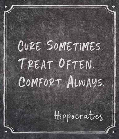 Cure sometimes, treat often, comfort always - ancient Greek physician Hippocrates quote written on framed chalkboard Zdjęcie Seryjne