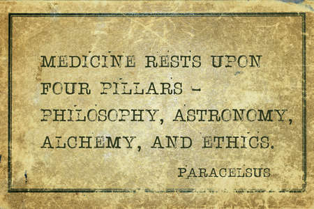 Medicine rests upon four pillars - philosophy, astronomy, alchemy, and ethics - Swiss physician and alchemist Paracelsus quote printed on grunge vintage cardboard