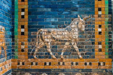 walking Aurochs symbol of Hadad deity on blue ceramic wall from ancient Babylon