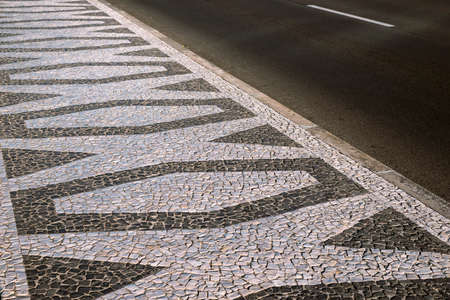 traditional cobblestone tile pavement ornament in Funchal city, Madeira Island, Portugal