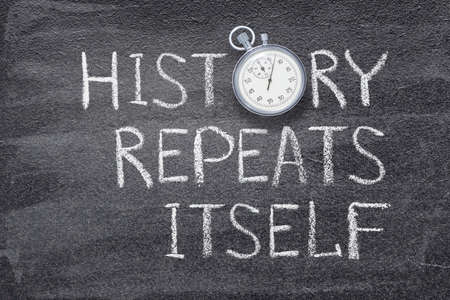 history repeats itself saying written on chalkboard with vintage precise stopwatch