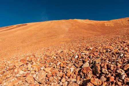 bright rough volcanic landscape with dark blue sky Stok Fotoğraf